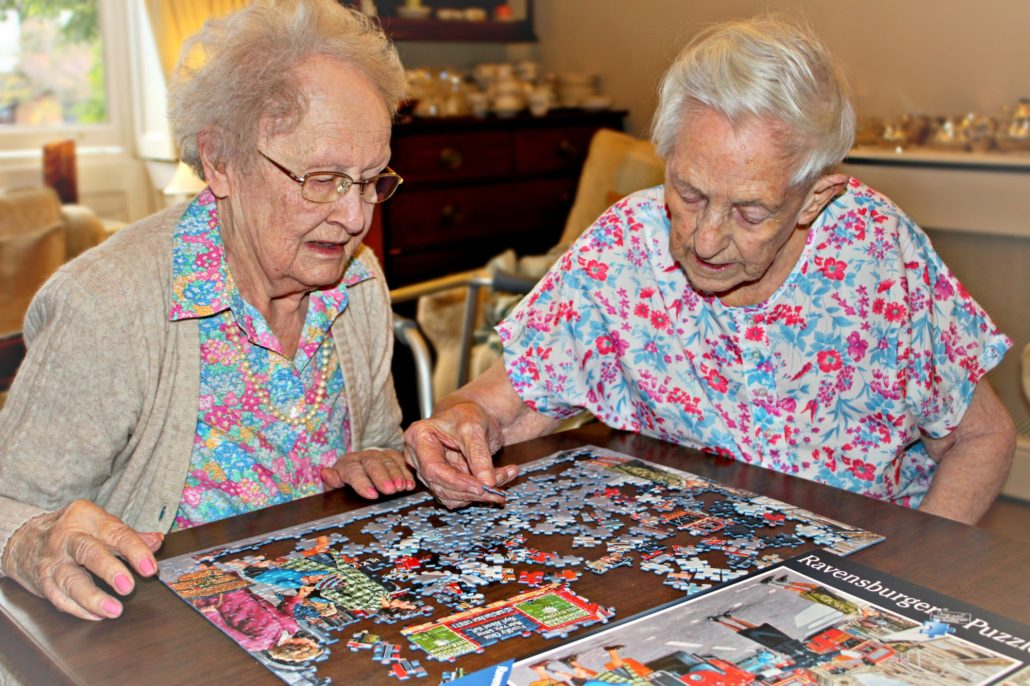 Residents completing a jigsaw puzzle at Parade House in Monmouth