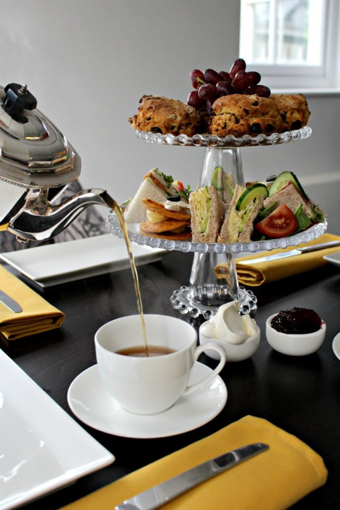 Dining at Parade House in Monmouth - Afternoon Tea is a meal composed of sandwiches (cut delicately into small triangles), scones with clotted cream and jam, sweet pastries and cakes.