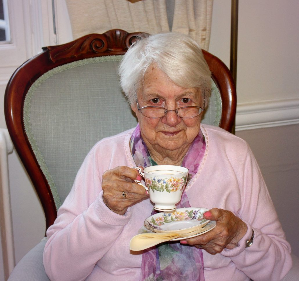 Resident enjoying a lovely cup of tea at Parade House in Monmouth