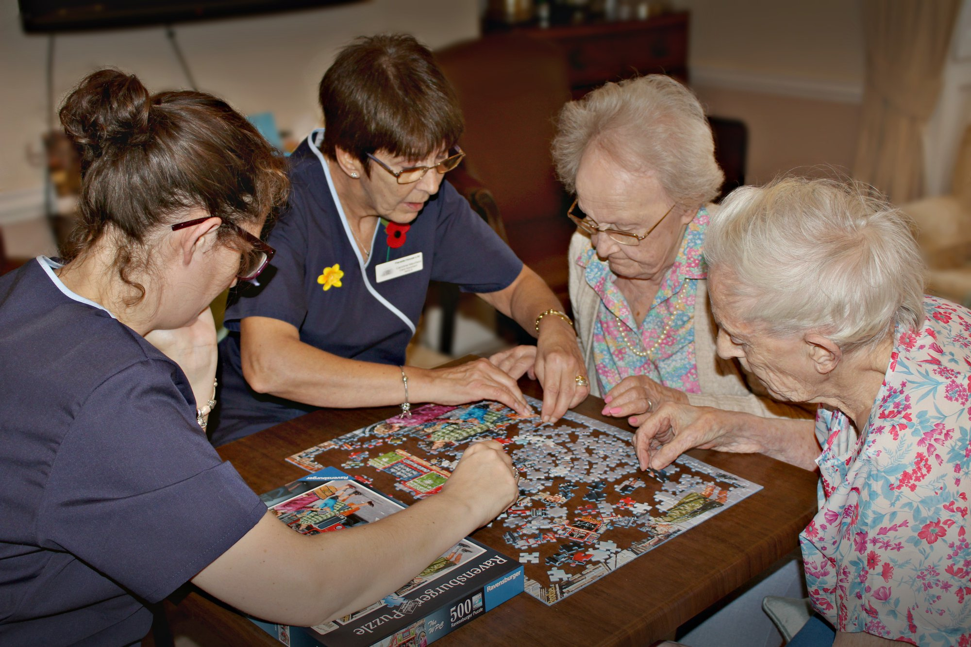 Parade House Activities - Staff and residents enjoying a puzzle at Parade House in Monmouth