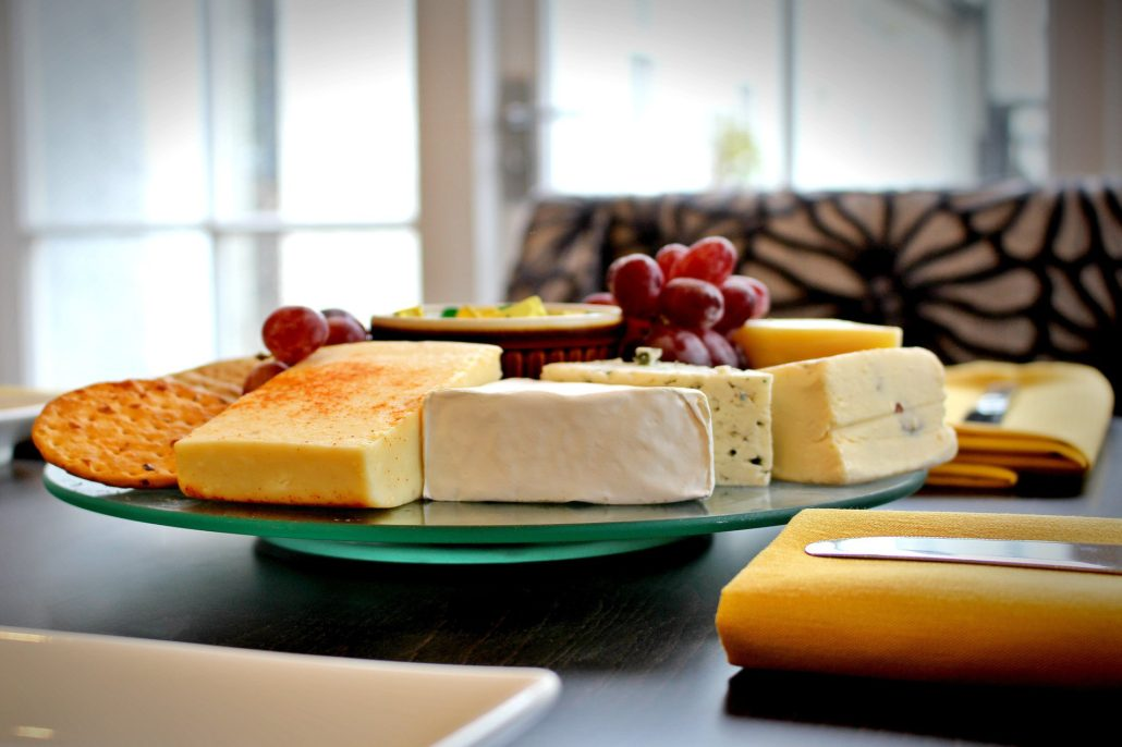 Dining at Parade House in Monmouth - Five different kinds of cheese, grapes and a selection of crackers and biscuits