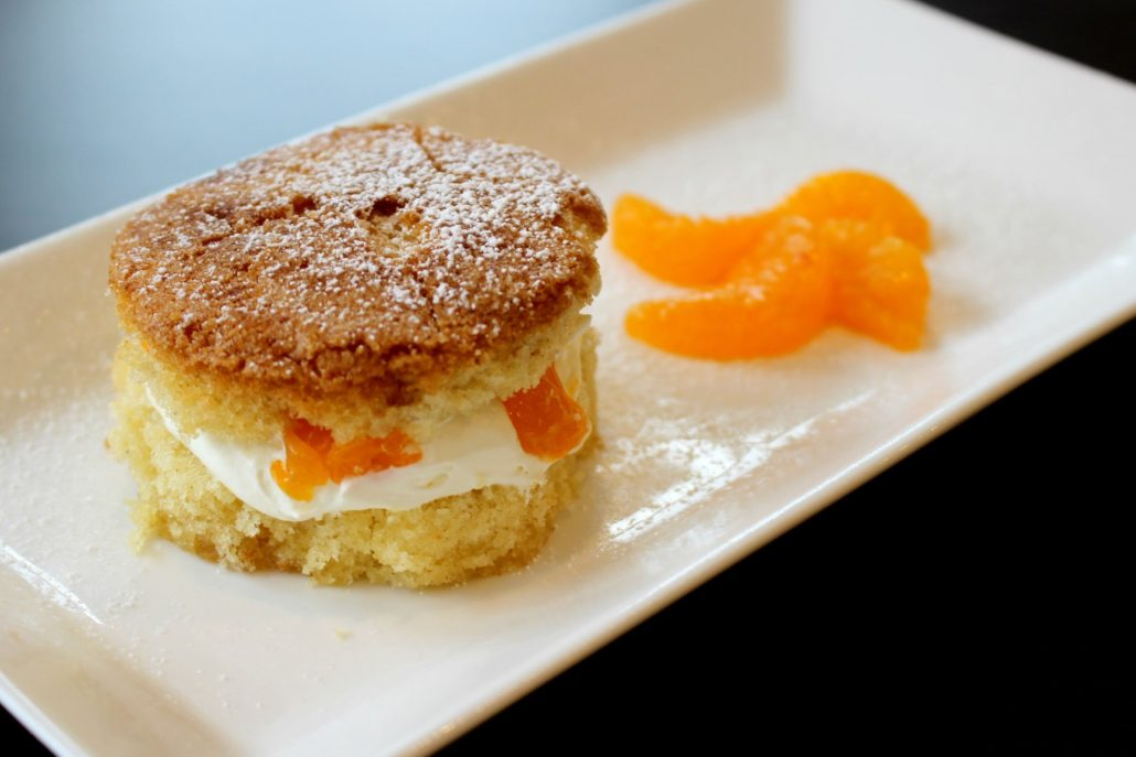 Dining at Parade House in Monmouth - Dessert with mandarin orange segments on a rectangular plate