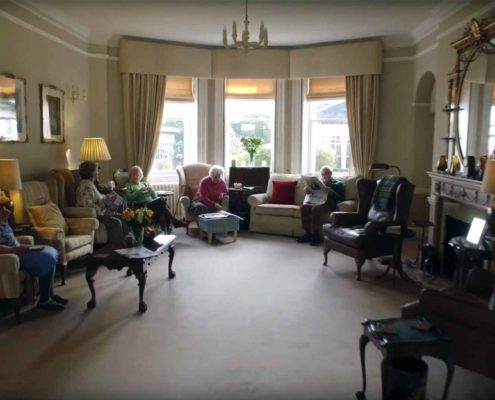 Residents relaxing in the comfortable lounge area at Parade House in Monmouth